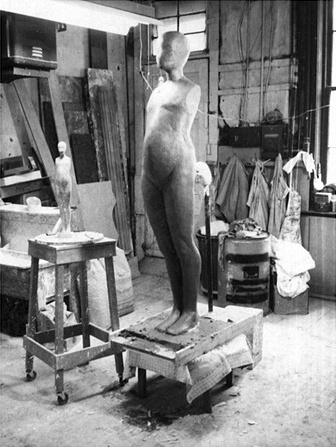 Polaroid of original clay sculpt of six foot FM figure with 24 inch reference casting, circa 1966.