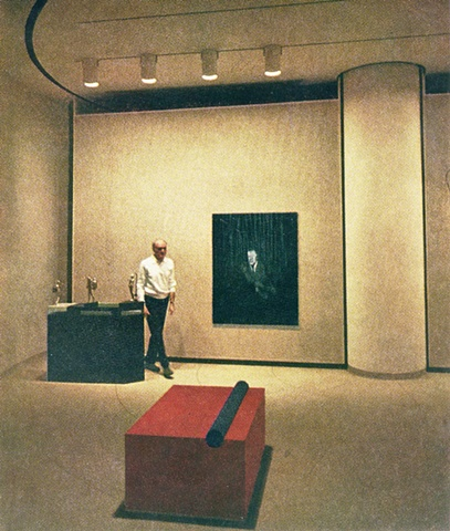 Johnson with works in his collection by Ernest Trova, Francis Bacon, and Donald Judd.