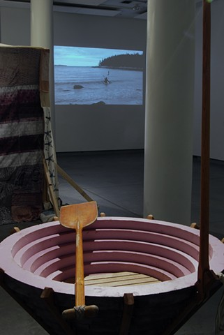 installation shot of boat and video (Institute of Contemporary Art, Portland Maine)
