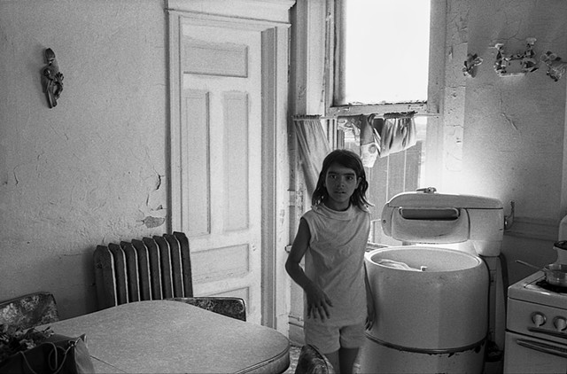 Girl and washing machine, Patterson Street apartment, Chicago