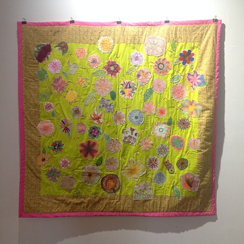 Flower Patch appliqué quilt created during Garden Walk Buffalo 2016, participants each drew a flower that was appliqued onto quilt
