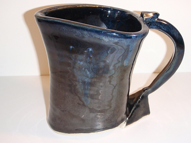 Shiny black triangular porcelain pitcher