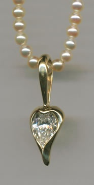 Diamond and Pearl with 18kt. Gold