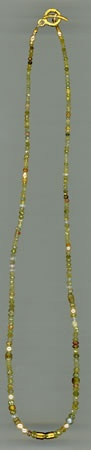 Diamonds, Sapphire, Akoya Pearls and Spinel with 24kt. Gold