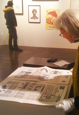 Mari reading The Chronicle Times at the  Kala Artists' Annual, 2013