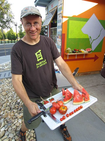 Michael Asbill at the Corcoran with vegetables from urban farms.