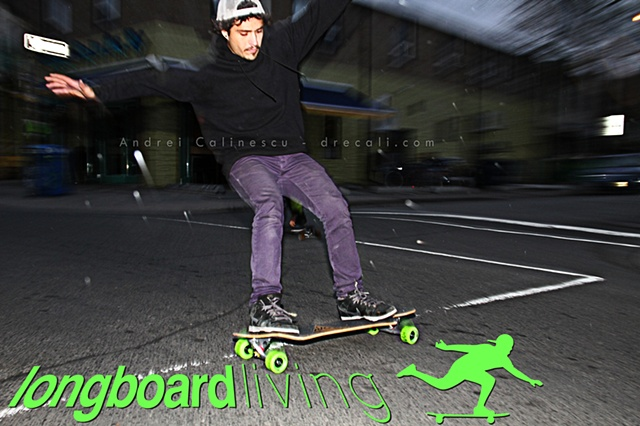 Nethanial Cohen bustin a long stand-up slide ( standy ) on a BOZ custom longboard in Kensington Market in Toronto, in partnership with Longboard Living