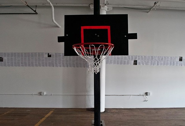 A site-responsive installation addressing the deeffication and ultimate crucifixion of the black male youth as sports star