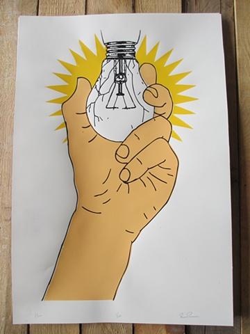 Hand Holding Breaking Lightbulb