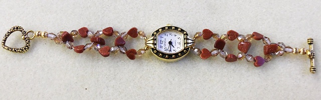 watch with goldstone hearts