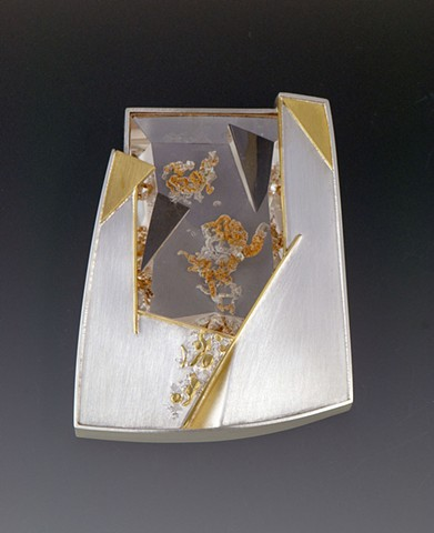 "Eleanor Moty Oryn Brooch 2 ½ "" x 1 7/8"" x 7/16""				 Sterling silver, 22K gold, quartz with phantom crystal Tom Munsteiner, lapidary artist, Idar Oberstein, Germany"