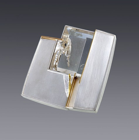"Eleanor Moty Crystal Cavern Brooch 2 ¼"" x 2 1/16"" x 3/8""			 Sterling silver, 18K gold, quartz with phantom crystal Tom Munsteiner, lapidary artist, Idar Oberstein, Germany"