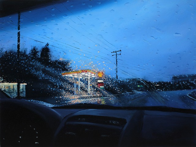 gas station through a rainy windshield