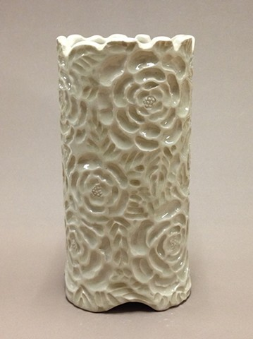 white stoneware vase with clear glaze and carved intaglio surface decoration