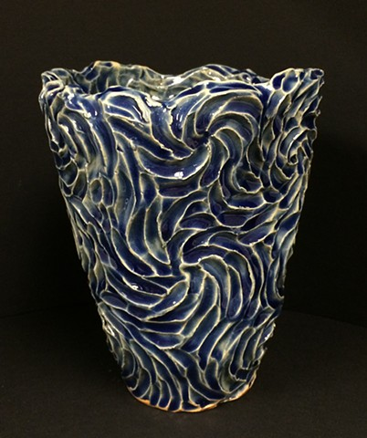 stoneware vase with deep blue glaze and intaglio surface texture