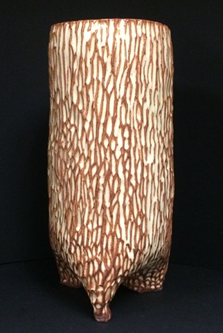 large carved stoneware vessel with cream/tan glaze