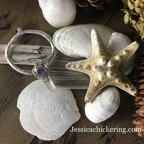 Beautiful handmade crystal pendent with recycled jewelry sparking stone on a silver hoop