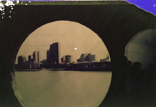 Polaroid negative scan- Toledo at sunset Orig. photo shot by Tim Hyma