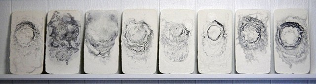 Breaths blown into plaster in conjunction with ink dripped in succession until plaster sets