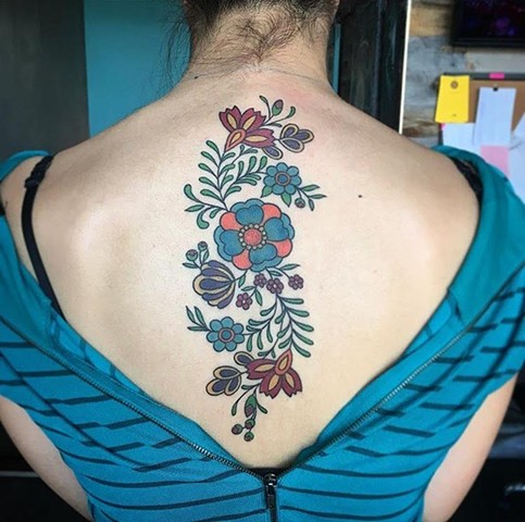 Mexican art/floral spine piece