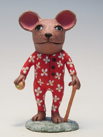 Clay mouse in red flowered pajamas.