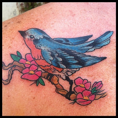 Bluebird on her shoulder...