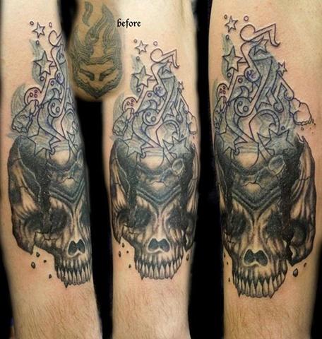 Black & Grey Skull (Bob Tyrell flash) w/ Custom music notes.  In progress