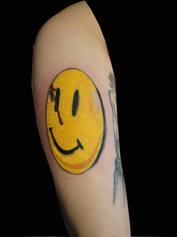 smily face tattoo