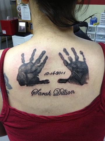 hand print tattoo