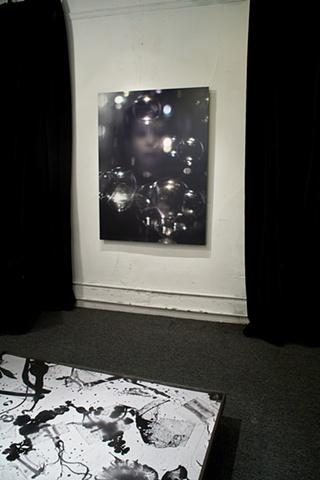 Sangyon Joo on wall, Klea McKenna on floor