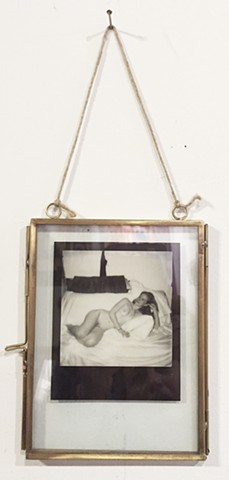 framed in a metal and glass floating frame