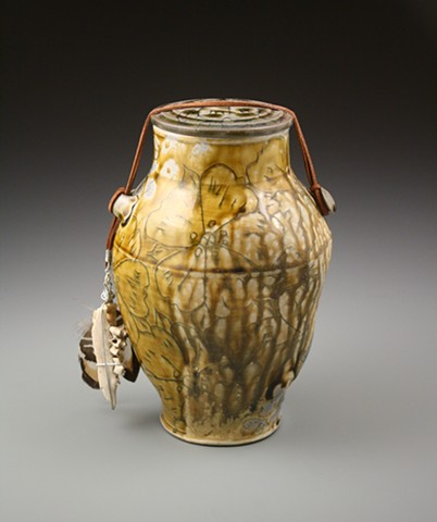 Amber Funerary Urn w/ rawhide, deer jaw fragment, pheasant feather