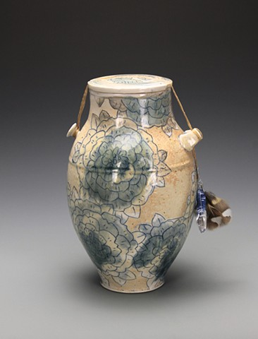Floral Funerary Urn with sinew, feathers, found glass
