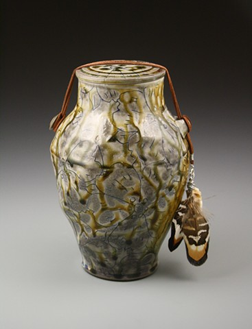 Amber Funerary Urn w/ rawhide, tooth, pheasant feather