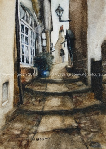 Watercolour painting of cottages in an alleyway in Robin Hood's Bay, North Yorkshire.