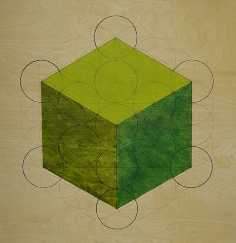 Green cube created from flower of life pattern.