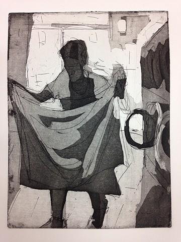 Laundromat - Woman walking/folding