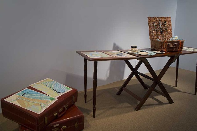 RIVER CAMPAIGN in Longue Vue House Gallery: Campaign Table from Longue Vue House collection (c. 1910) with River Campaign Picnic Basket contents and river charts.