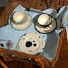 RIVER CAMPAIGN: Partial contents of River Campaign Picnic Basket: hand-painted china, hand-embroidered napkins, and hand-painted flatware