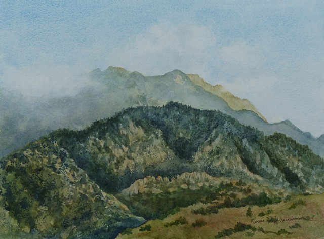 watercolor of pikes peak with cloudcover greens and ochers