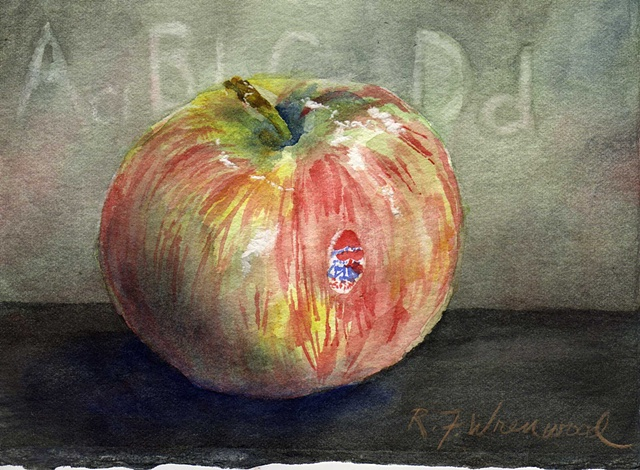 a MacIntosh apple with blackboard behind