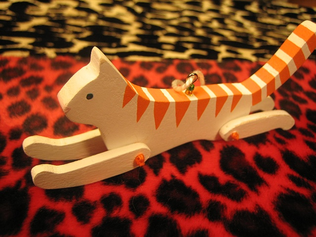 wooden orange striped kitty jointed ornament