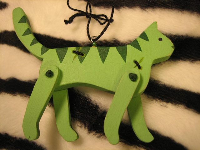 green wooden zombie kitty jointed ornament