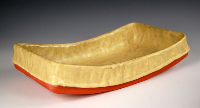 yellow curved dish