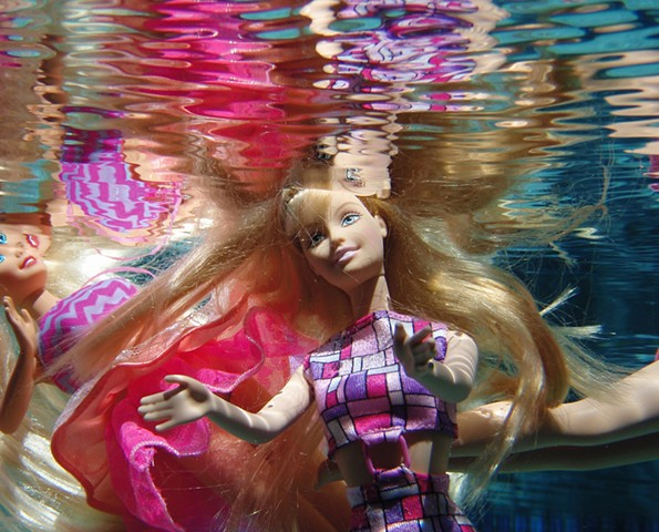 Photograph of Barbie Doll and her reflection by Daena Title