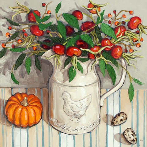 Rose hips in a country jug