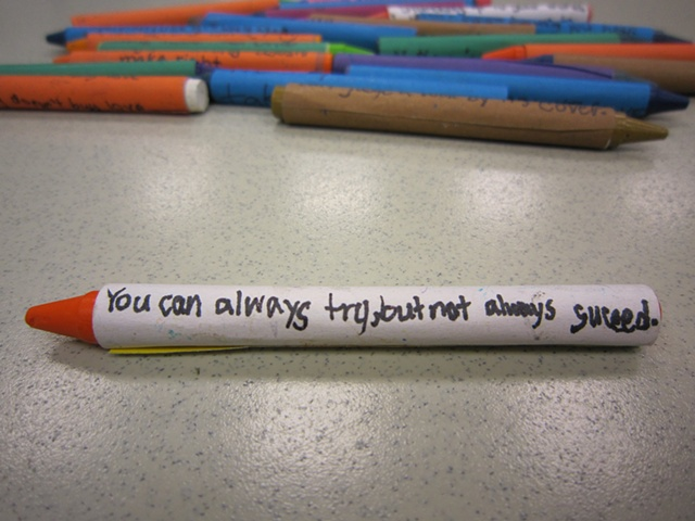 "Student Work (4th grade) Crayon with custom-made wrapper Artwork inspired by Jenny Holzer's ""Truth in Advertising"""