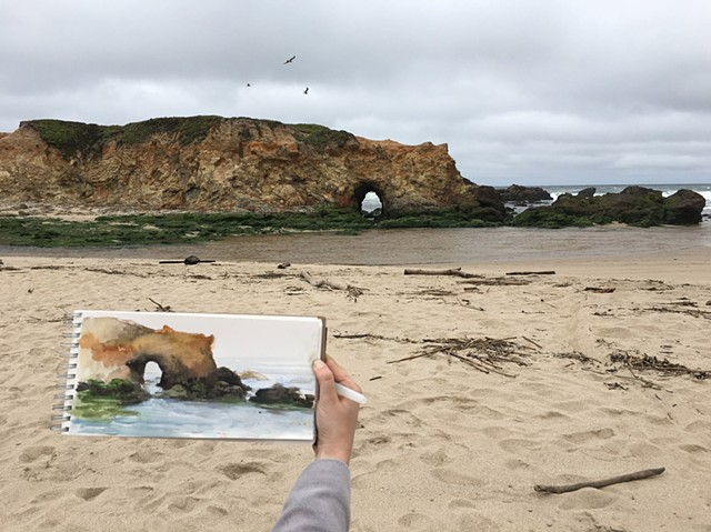 Painting the arch at Pescadero Beach, California