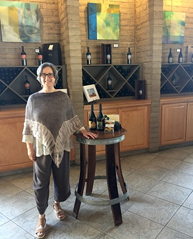 Lisa Aksen with her art on exhibit at Wente Vineyards