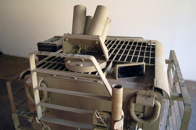 SAFE (detail) Rear RPG defense grating and 55mm smoke grenade discharger